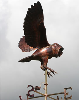 A hunting barn owl weathervane